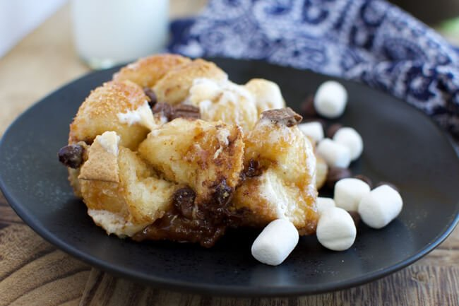 a black plate with chocolate and marshmallow pull apart bread