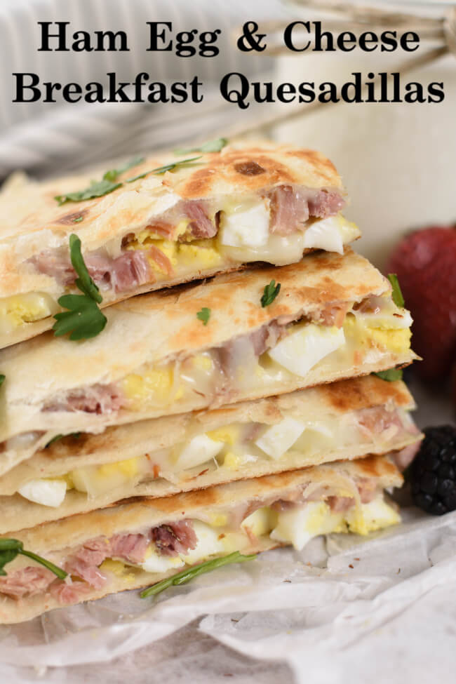 a stack of quesadillas stuffed with hard boiled eggs, cheese, and diced ham