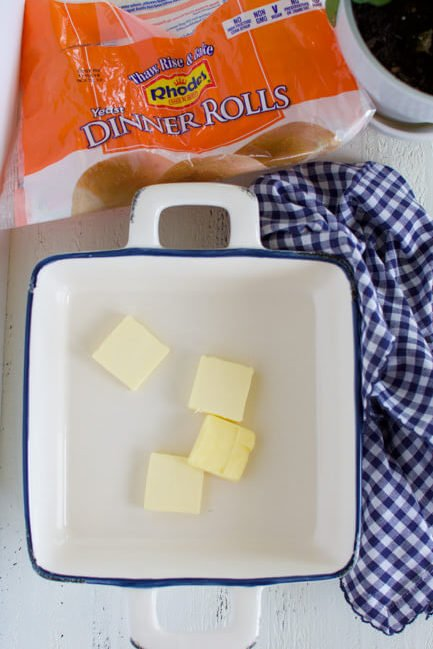 a baking dish with slices of butter