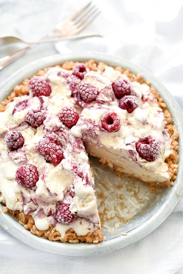 vanilla ice cream pie with frozen raspberries and a rice krispie crust