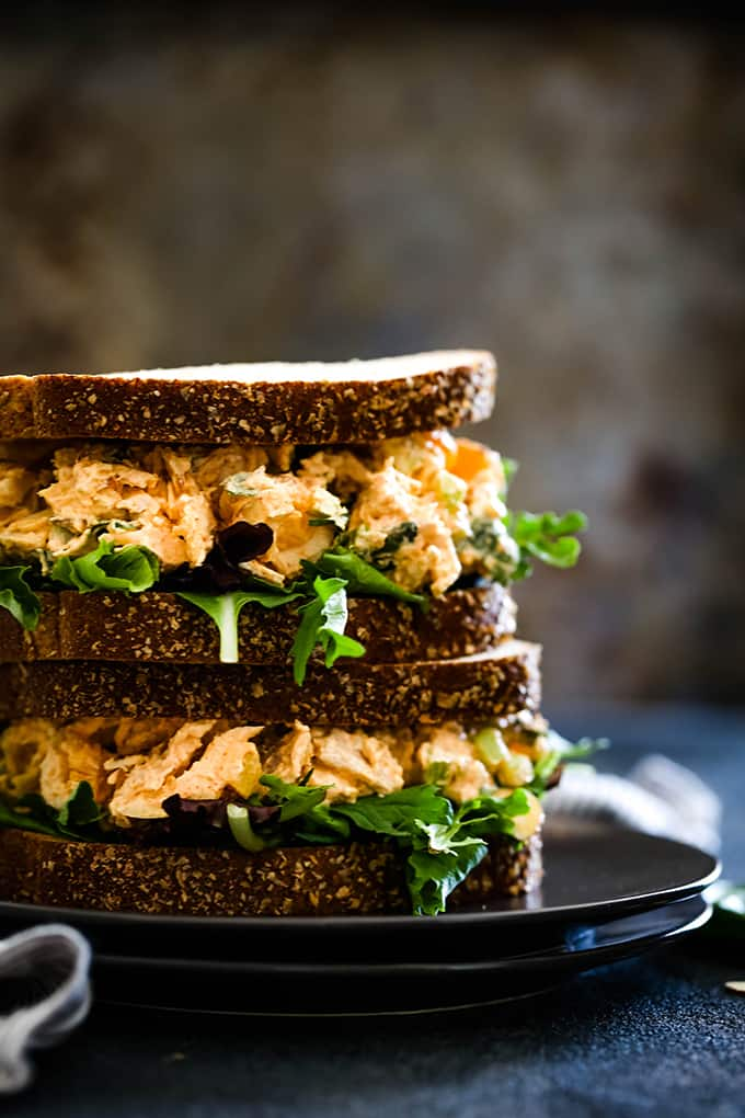two sandwiches filled with creamy chicken filling