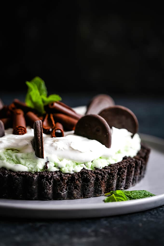 chocolate tart crust topped with mint ice cream, whipped cream, and mint cookies