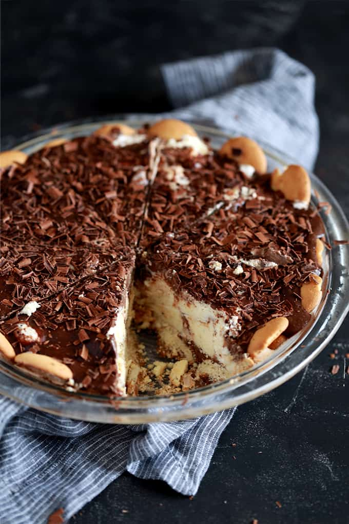 a pie made with vanilla ice cream in a crumb crust and topped with chocolate curls