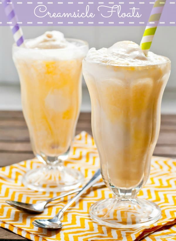 two glasses with orange juice and vanilla ice cream with a straw