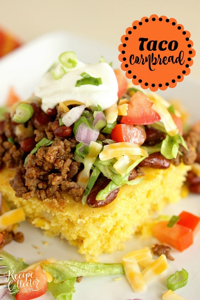 a square of cornbread topped with taco meat, lettuce, tomatoes, cheese, and sourcream