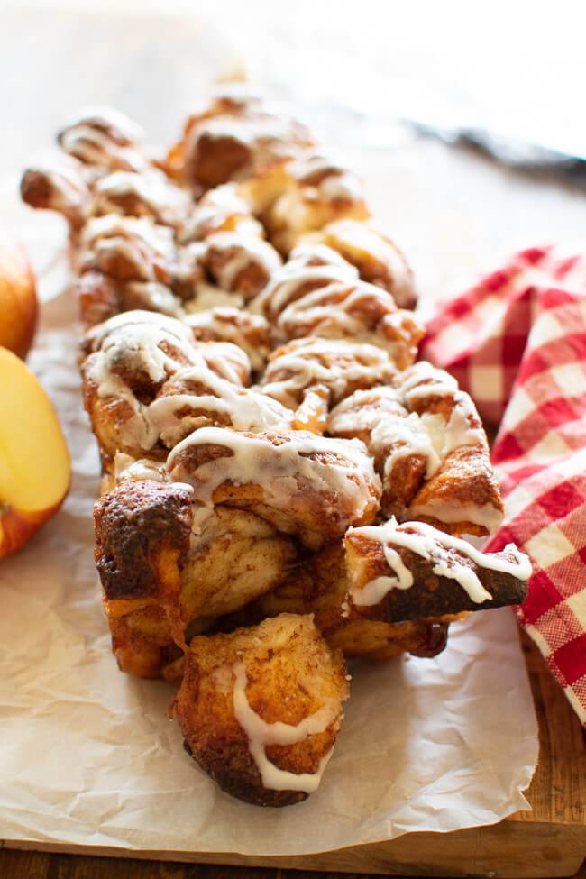 a loaf of apple bread with streusel and frosting