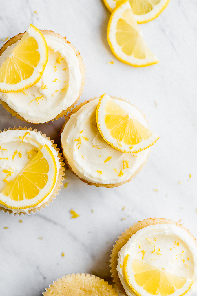 cupcakes with white frosting and a lemon slice on top