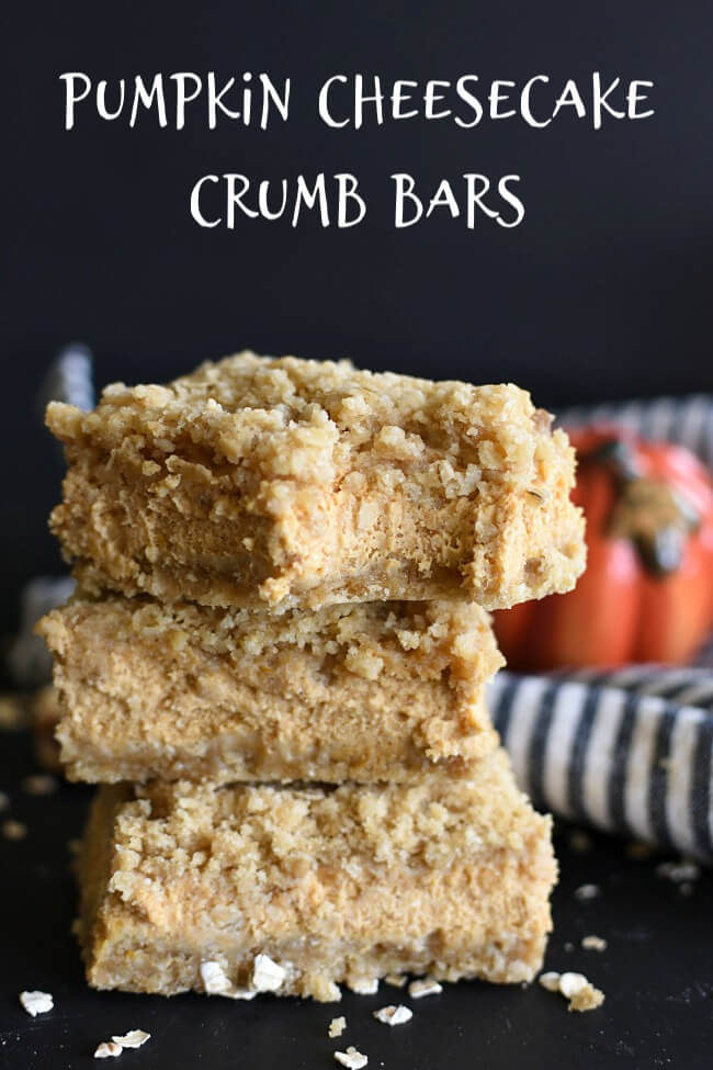 a stack of bar cookies with a pumpkin filling and crumb crust