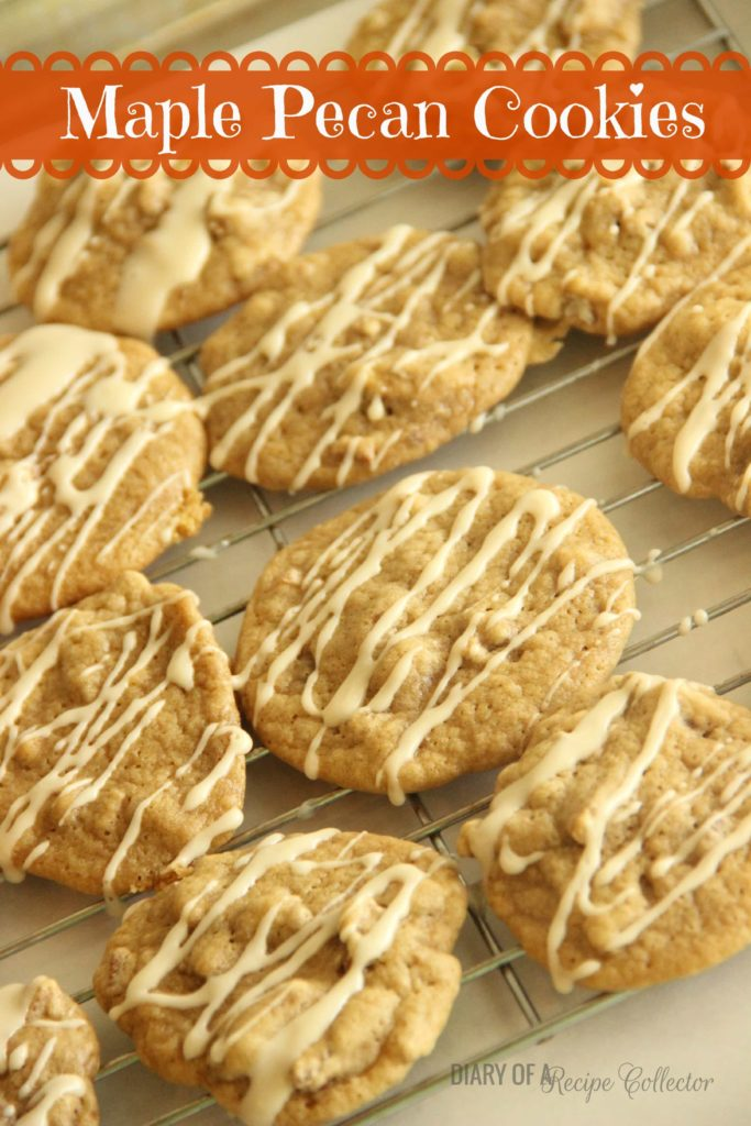 a cooling rack with golden brown maple cookies drizzled with maple glaze