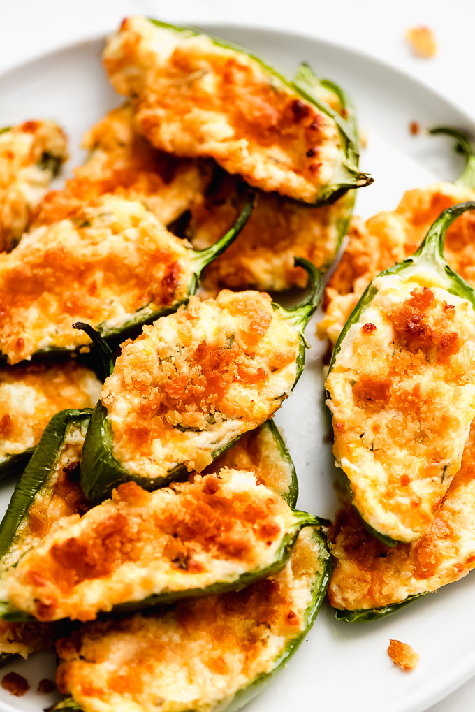 baked jalapeno poppers topped with crispy baked cheddar cheese