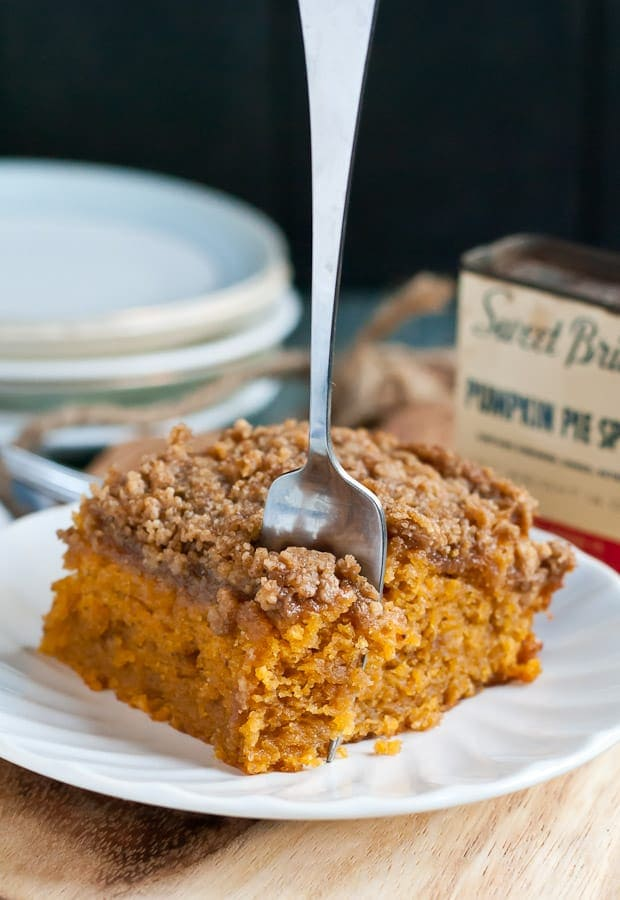 a square of pumpkin cake with strudel topping and a fork stuck in it
