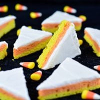 cookies cut into triangles that have yellow, orange, and white layers