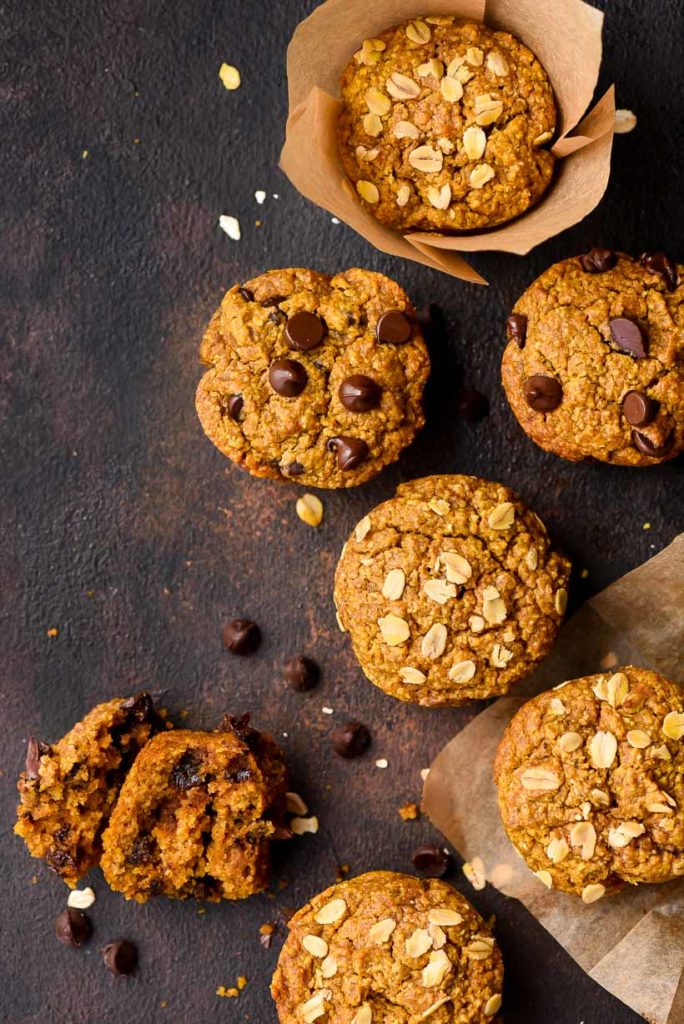 gluten free pumpkin muffins with chocolate chips and oats on a black board
