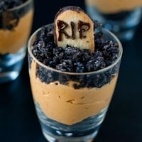 glasses with layers of chocolate pudding and crushed chocolate sandwich cookies, and a RIP decoration