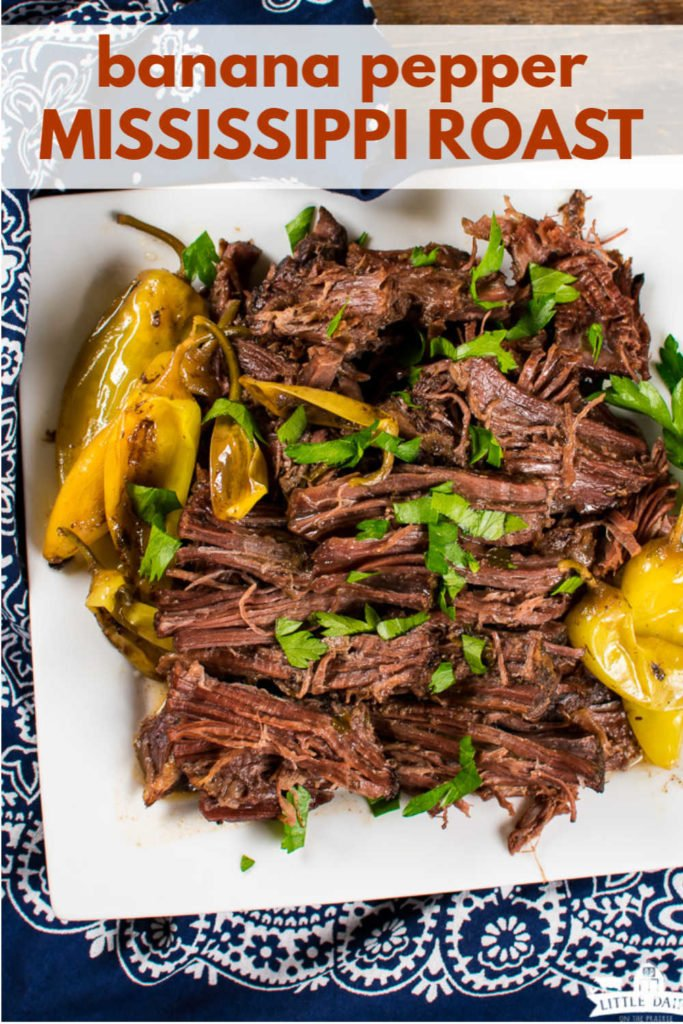 an overhead image of shredded roast beef on a plate with banana peppers
