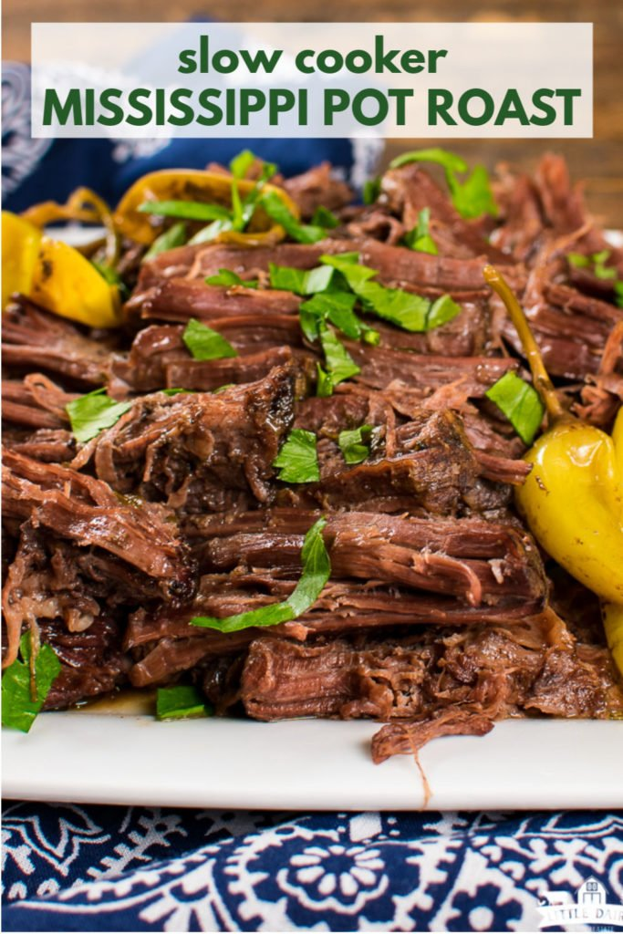 an image with a plate of shredded roast beef sprinkled with chopped parsley and pepperoncini's on the side