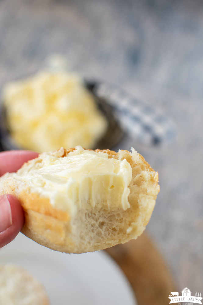 half a buttered roll with a bite taken out of it