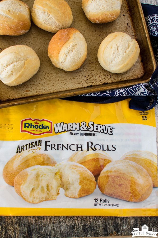 Yellow and white packaging from artisan french dinner rolls and a baking sheet with rolls