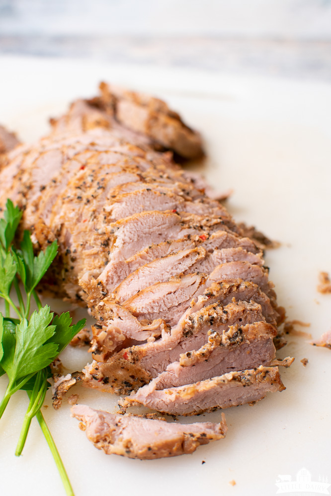 seasoned, cooked, and sliced pork tenderloin that was cooked in a pressure cooker
