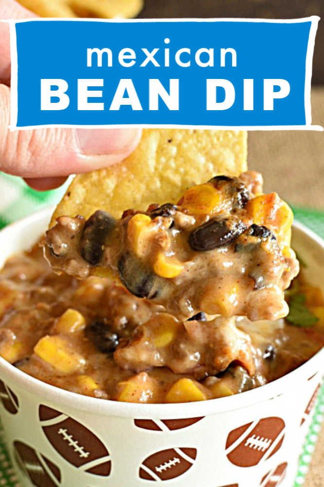 a paper cup with dip made with beans, corn, and ground beef with chips and a text overlay