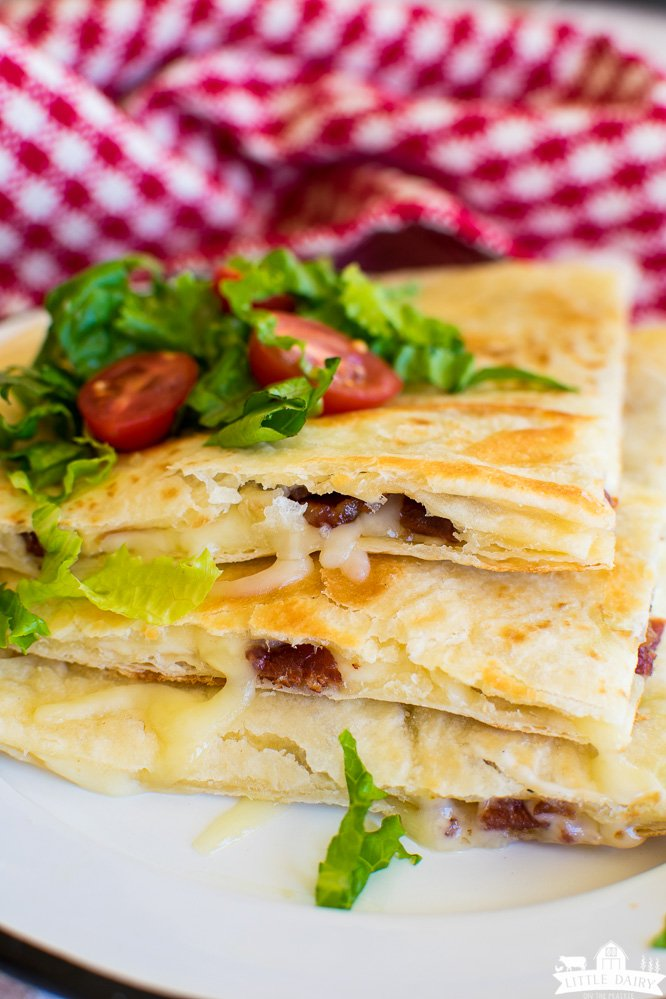 Golden brown quesadillas made with bacon and white cheese.