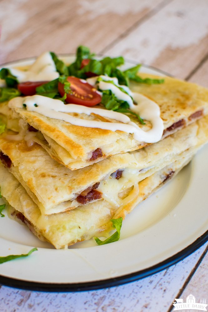 wedges of cheese quesadillas drizzled with ranch