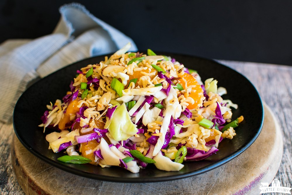 cabbage salad on a black plate