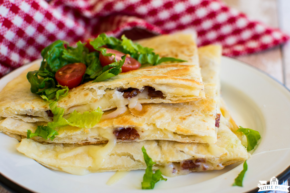 quesadillas wedges with shredded lettuce and diced tomatoes