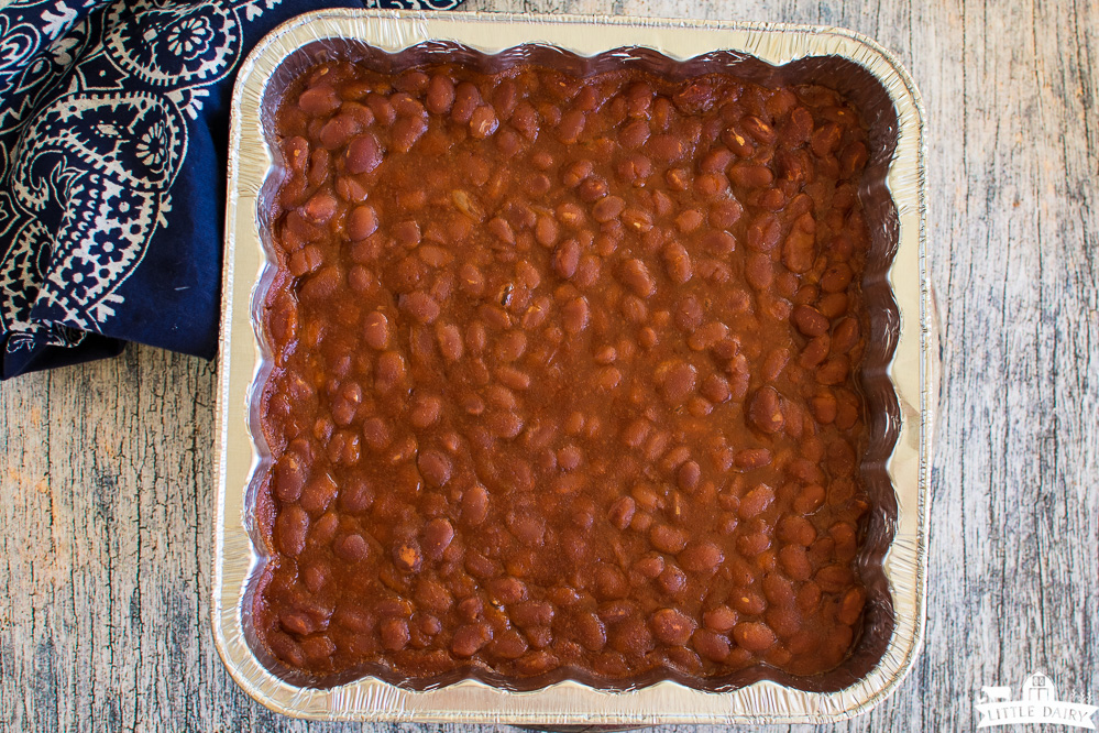 cooked baked beans in an aluminum pan