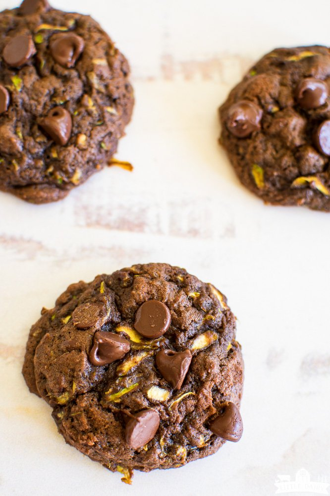 three zucchini, chocolate, and chocolate chip cookies on a white board