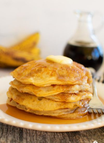 a stack of fluffy pancakes with butter on top