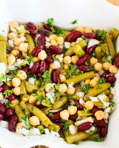 close up image of 3 different kinds of beans in a salad