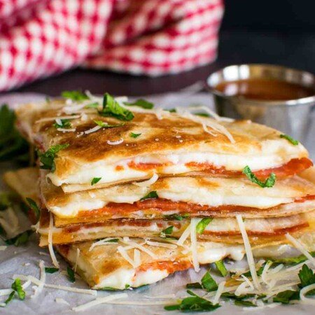 wedges of cooked quesadillas with pepperoni and cheese