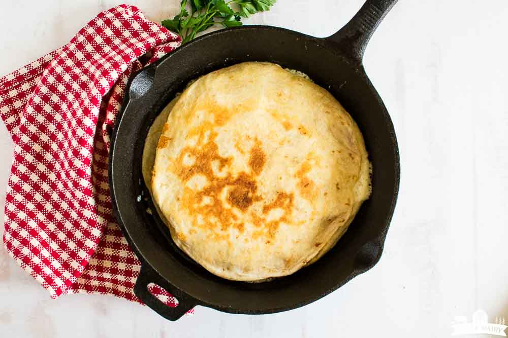 fried cheese quesadilla in a skillet