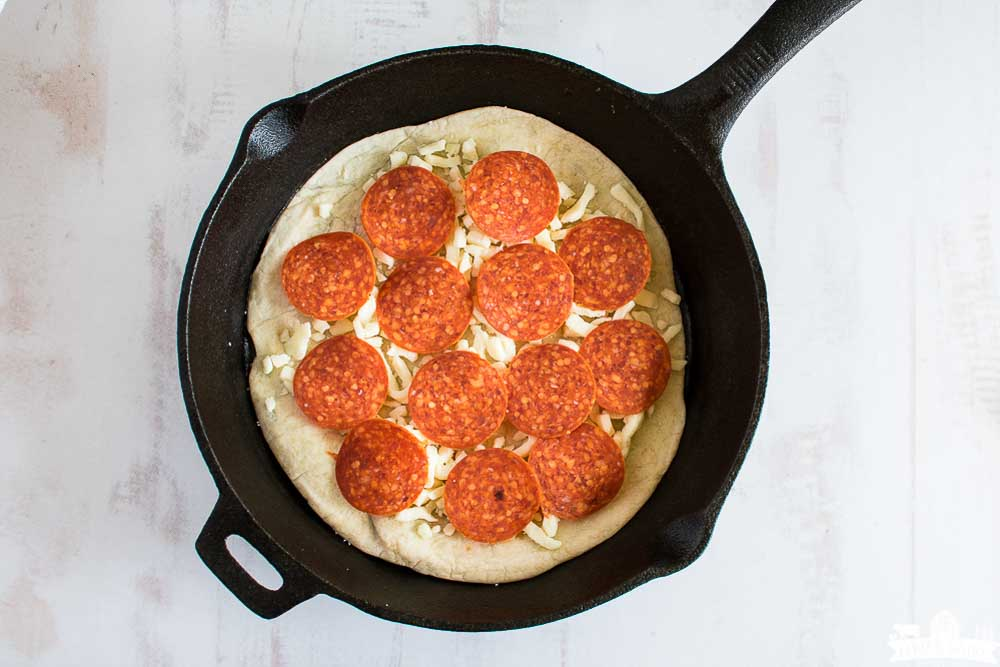 flour tortilla, cheese, and pepperoni in a skillet