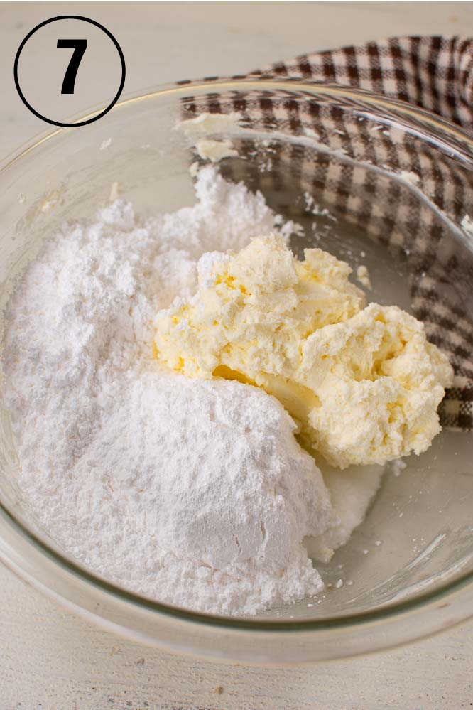 cream cheese, powdered sugar, and butter in a glass mixing bowl