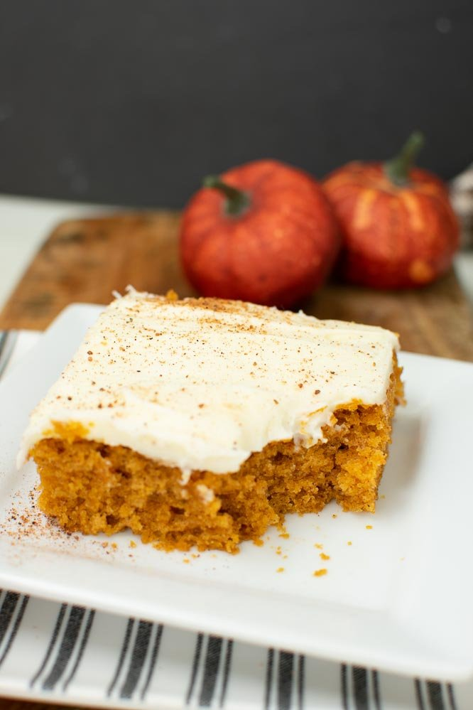 pumpkin bar on a plate with a bite taken out of it