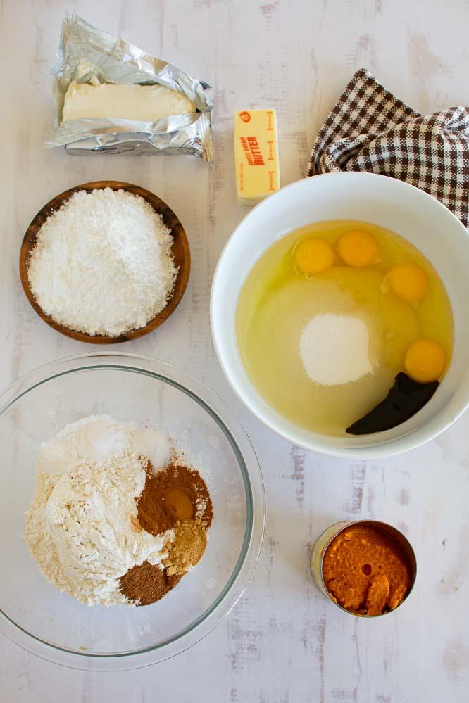 ingredient for making pumpkin bars; eggs, sugar, vanilla, dry ingredients, canned pumpkin, cream cheese, butter