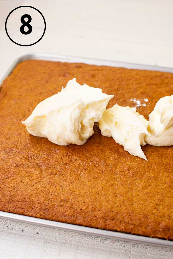 baked pumpkin bars with dollops of cream cheese frosting on top