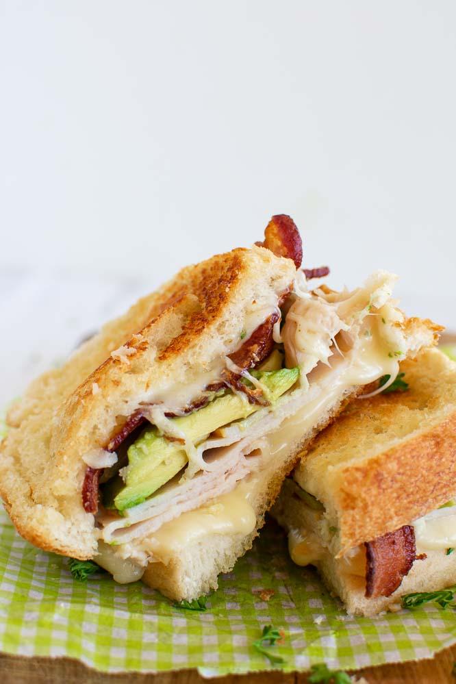 the inside of a half of a turkey bacon, avocado, ranch sandwich