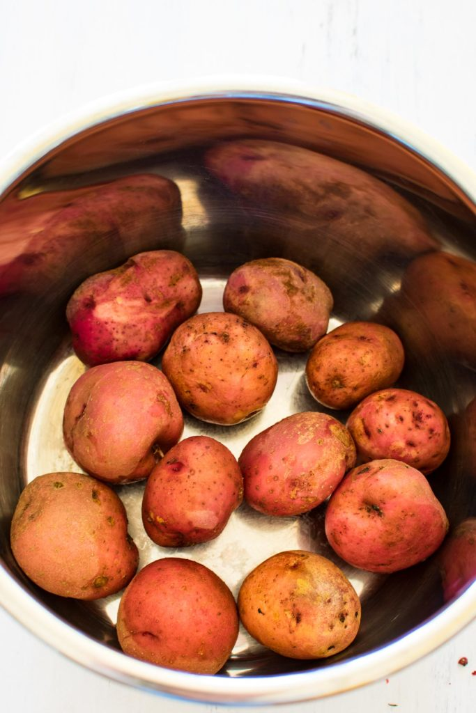 red potatoes in a pressure cooker.
