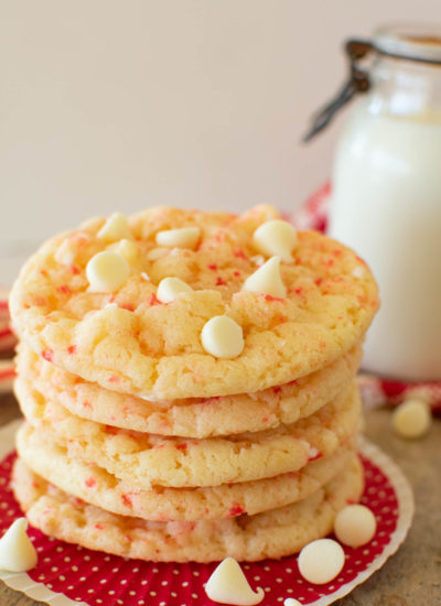 A stack of peppermint cookies with white chocolate chips and crushed candy canes.