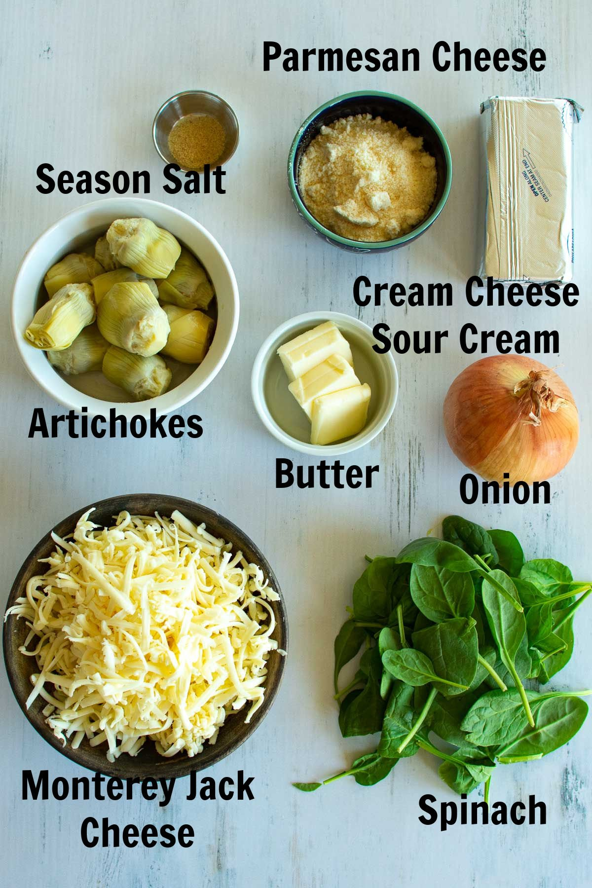 Ingredients needed to make artichoke dip.