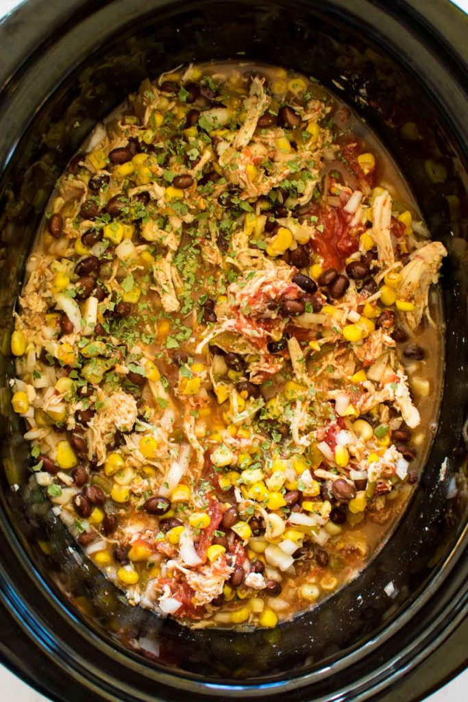 A slow cooker with chicken chili.