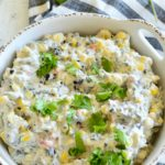 Veggie ranch dip with corn, beans, and herbs.