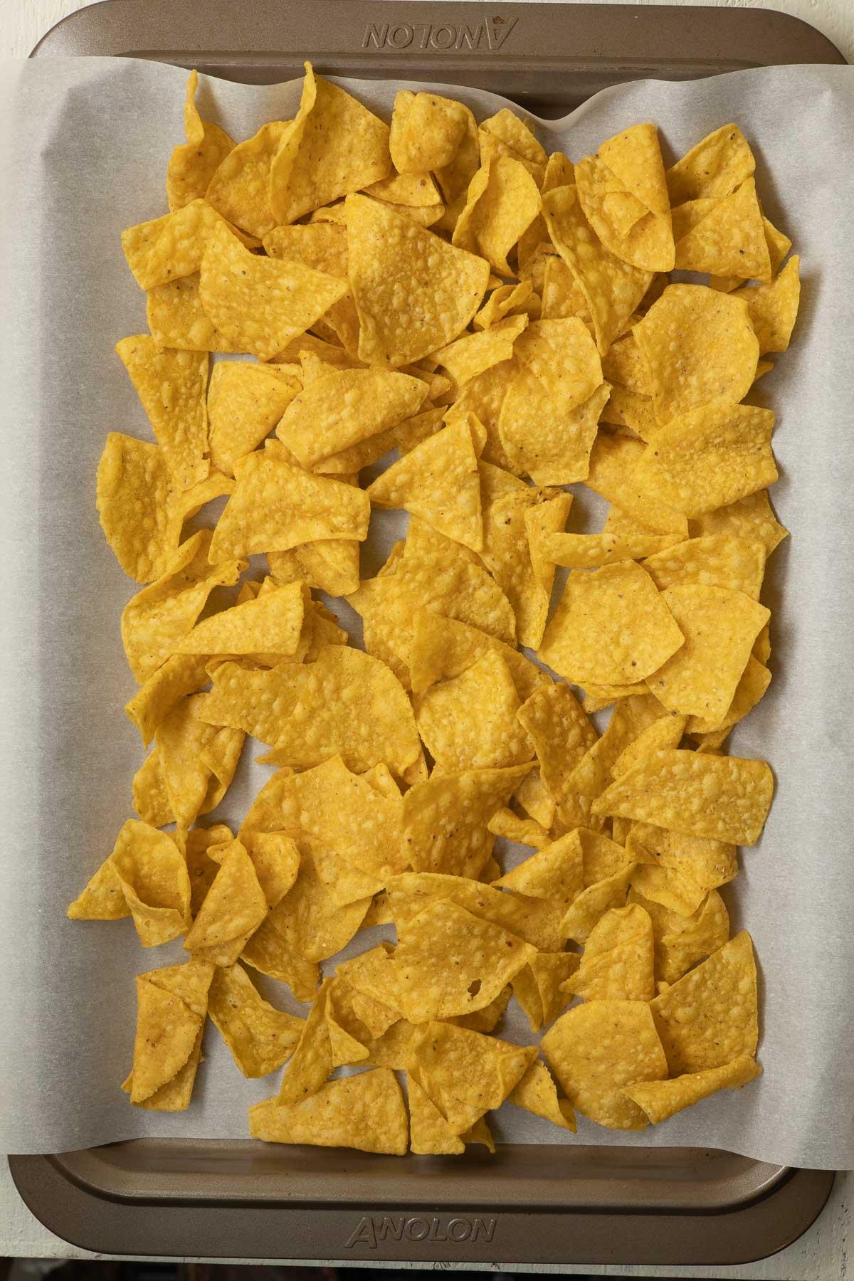 A sheet pan of tortilla chips.