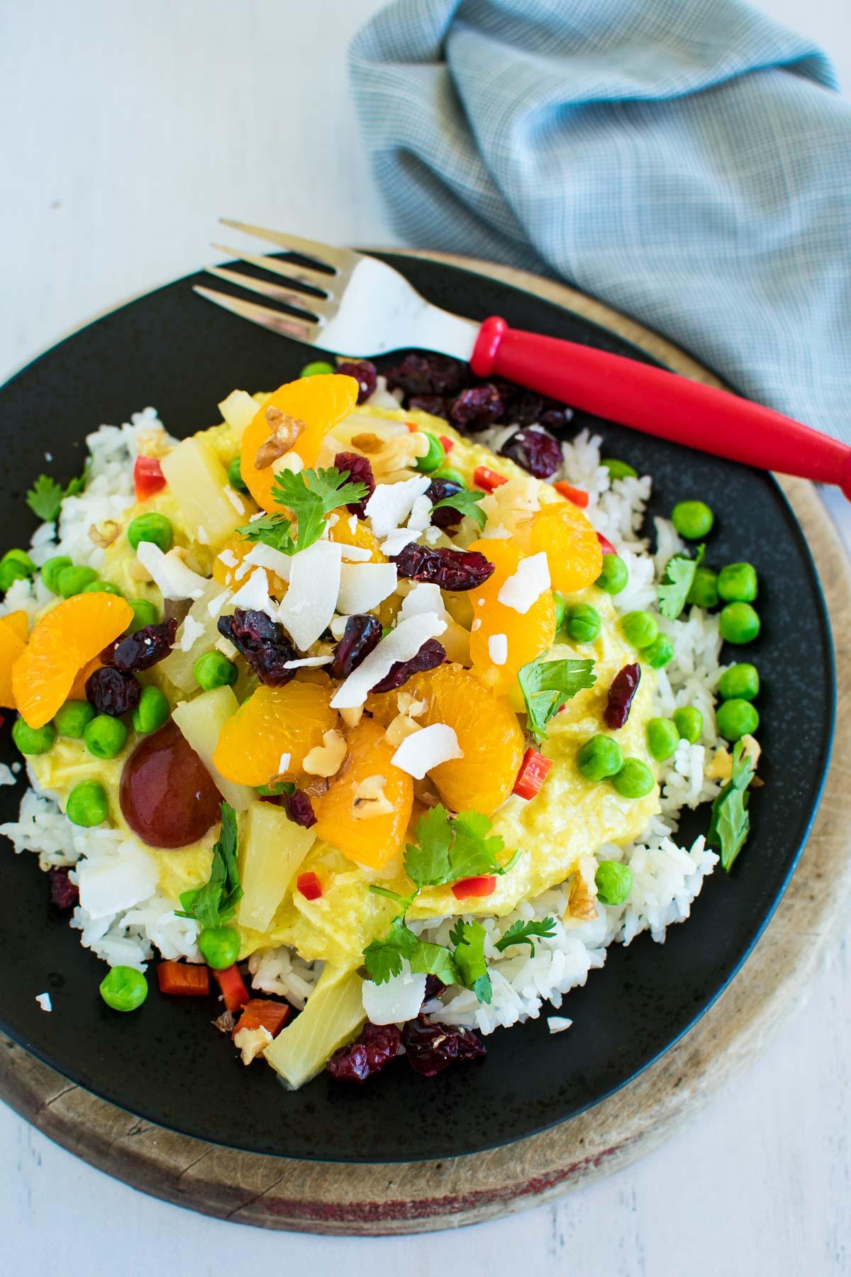 Hawaiian Haystacks recipe with curry, fruit, and veggies like pineapple.