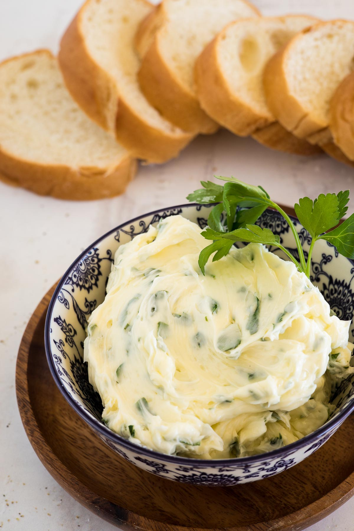 Garlic Butter in a dish with bread.