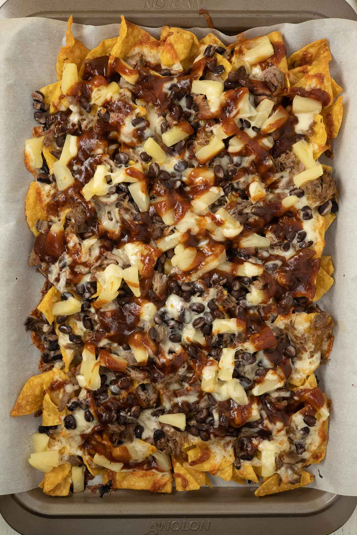 Baked nachos with barbecue sauce.