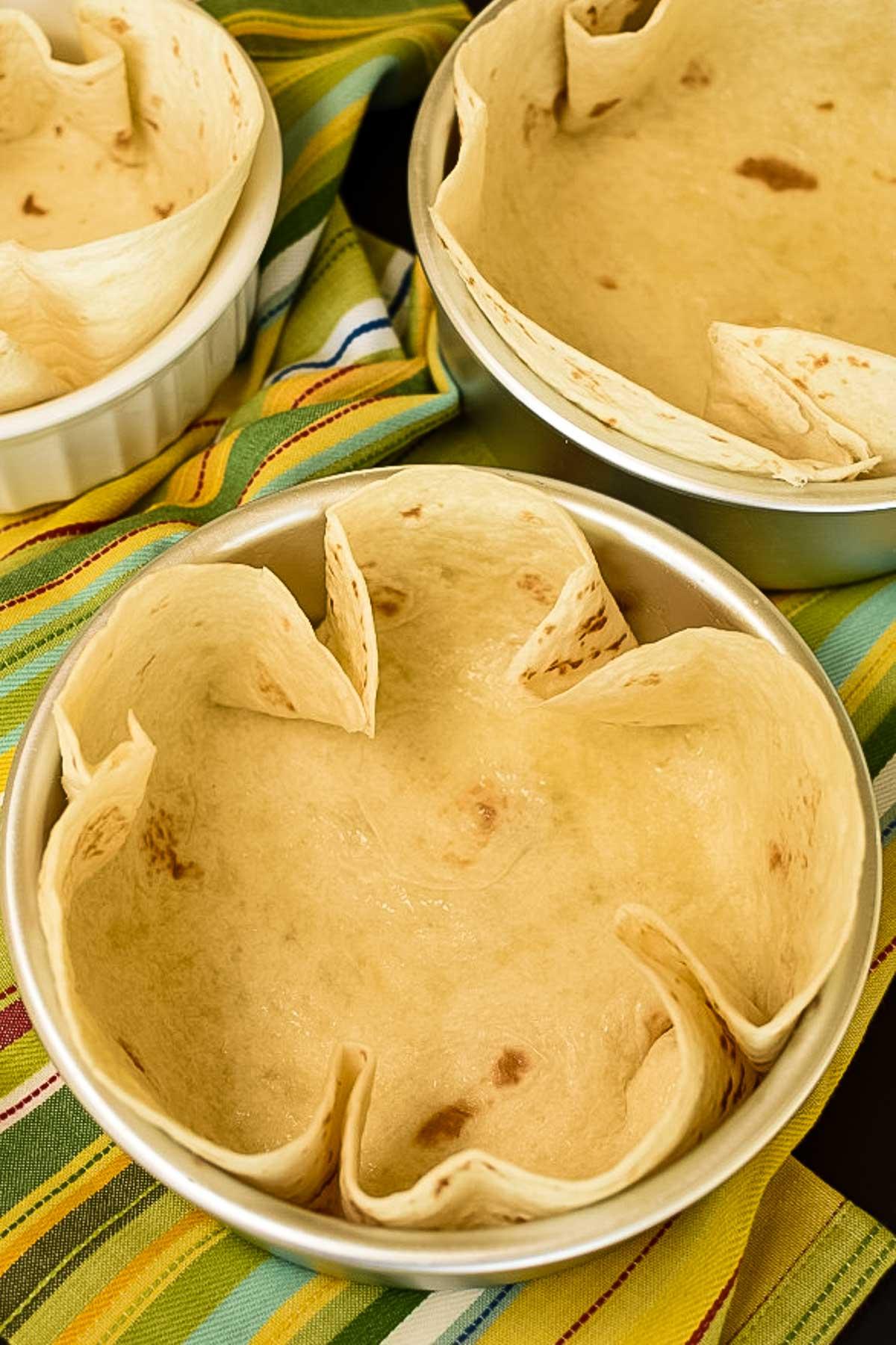 Oven-safe bowls with a flour tortilla.